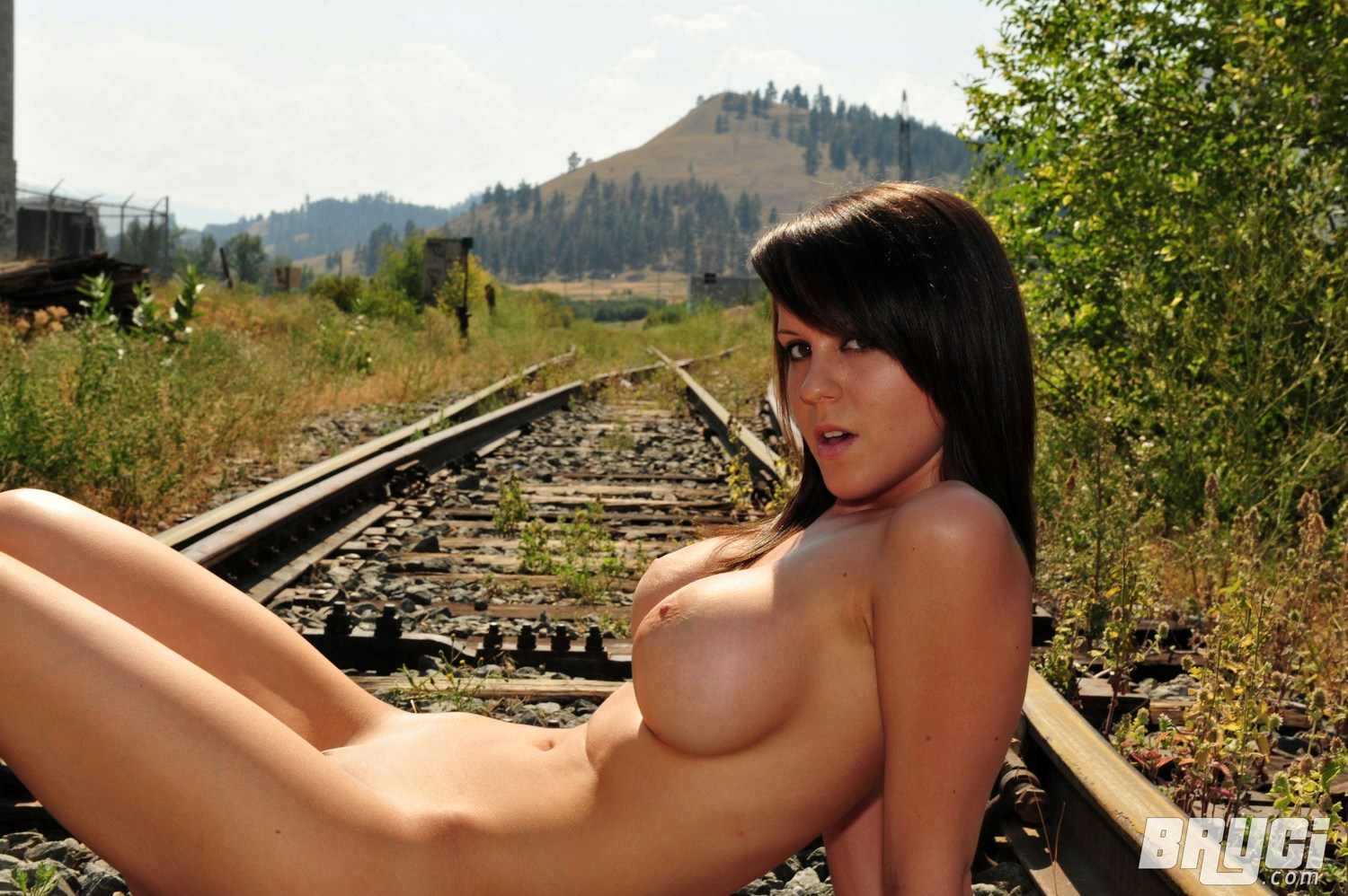 Pretty young women tied on railroad tracks naked state