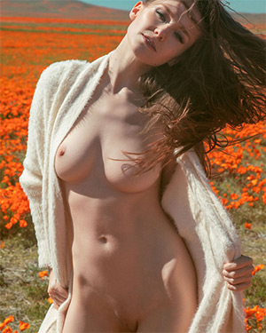 Emily Bloom Posing With Poppies