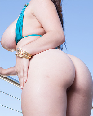 Noelle Easton Busts Out Of Her Bikini